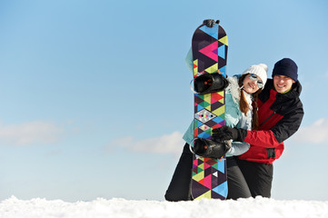 Happy sportswoman with snowboard