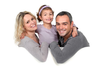 parents and their little girl on the couch