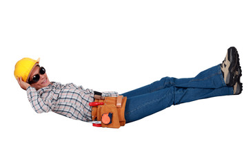 Happy female laborer lying on the floor