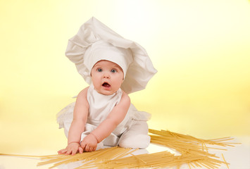 Little cook. Cute  baby dressed in a chef's hat and apron, with