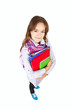 girl standing with backpack and books over white