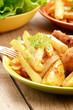 Fried drumsticks with french fries