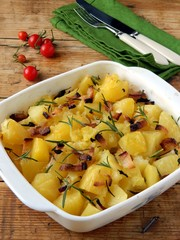 Potatoes baked with bacon and rosemary