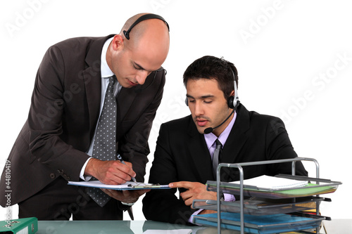 Office workers wearing headsets