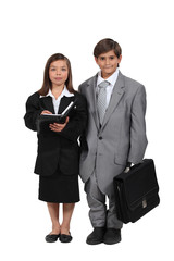 Little kids dressed as business people