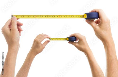 Leinwandbild Motiv Hands with measure tape set isolated on white