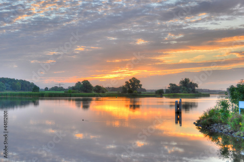 Summer sunrise over a small lake