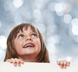 little girl with board with empty space - bokeh background