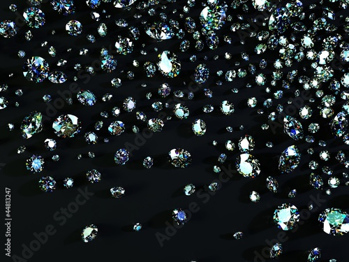 a variety of diamonds scattered on black surface