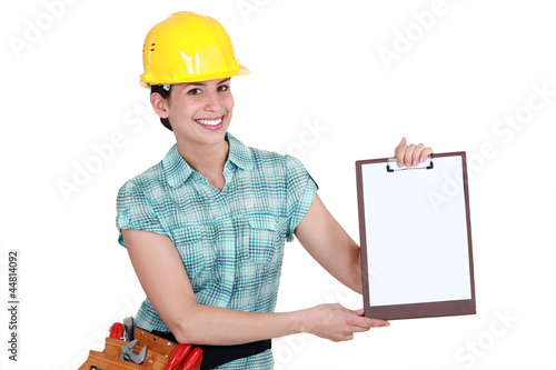 Woman pointing to clip-board
