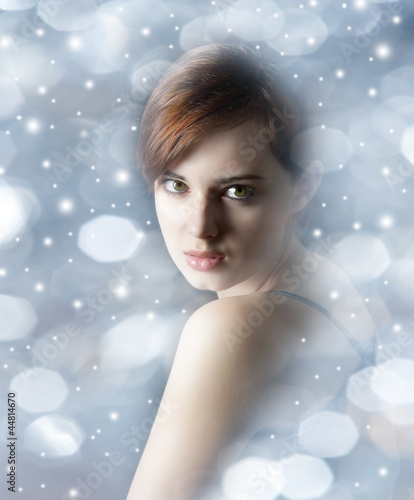 young woman with nice face on snowing background