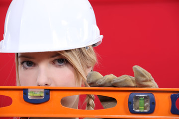 Female manual worker with spirit level