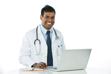 Male Asian Doctor working on a laptop.