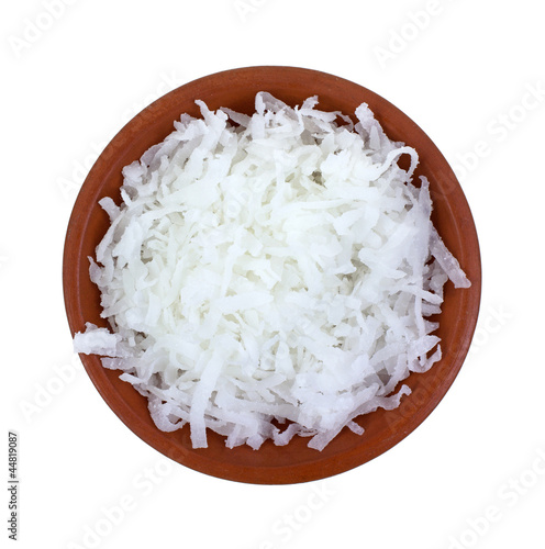 Shredded coconut in small bowl