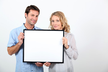couple holding frame