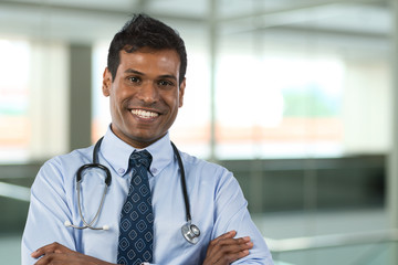 Male Indian GP doctor wearing shirt & tie.