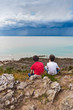 Kids Looking at a Storm over the Sea