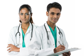 Two Indian doctors standing together.