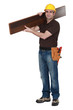 Man carrying parquet flooring