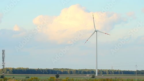 wind turbines on green field, alternative source of energy