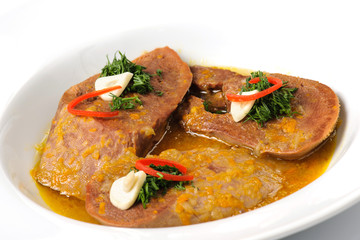 Stewed slices of beef tongue with sauce and seasoning