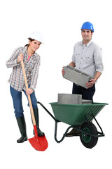 female bricklayer with shovel and male counterpart