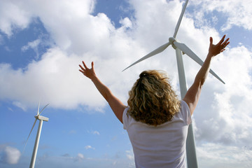 Woman in front of wind turbines
