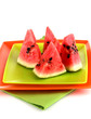 Sweet watermelon slices on plates isolated on white