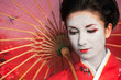 Asian style portrait of young woman with red umbrella