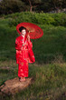 Geisha in the green hills at the sunset