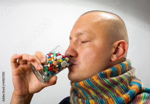 Man drinking pills