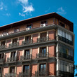 Architecture, brick spanish buildings with terraces and blue sky