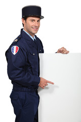 French policeman with poster