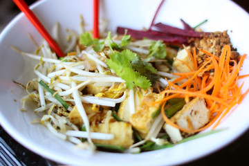 Pad thai with vegetables and tofu at a restaurant.