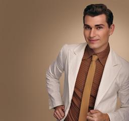 Elegant young man in jacket. Fashion model.