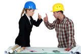 Engineer having an argument with a tradesman