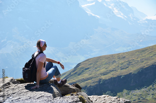 Traveler on the top of a mountain. Switzerland