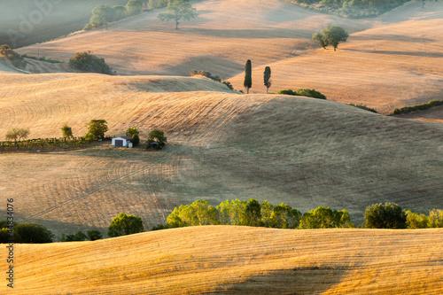 Sunrise in tuscan countryside near Pienza, Italy