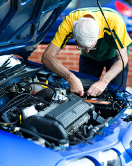 Man working on a car engine