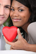 Couple holding a heart case