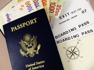 Passport, foreign currency, boarding passes, compass rose