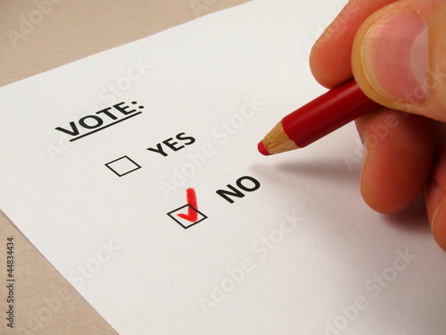 Voting  'no' with a red pencil