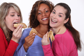 Three female friends enjoying crepes.
