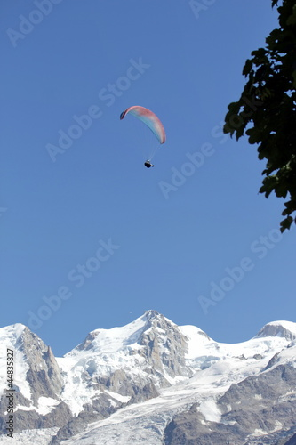 Paraglider upon the Alps mountains