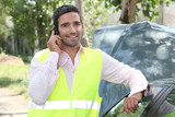 Man using a cellphone at a vehicle breakdown