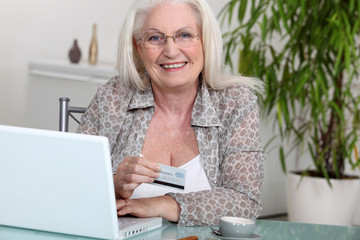 Senior woman paying online