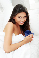 Happy smiling woman with cup