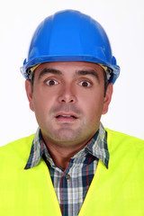 Alarmed construction worker