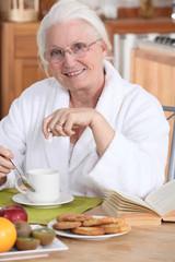 Old lady eating breakfast