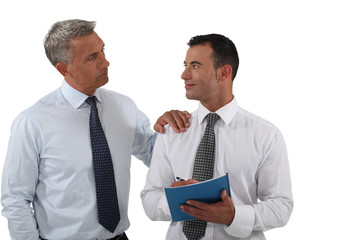 Two businessmen with a report